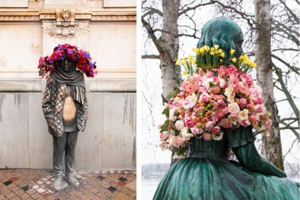 Florister dekorerar kvinnliga statyer på Internationella Kvinnodagen